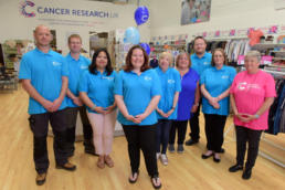 The Cancer Research UK Holyhead superstore staff and volunteer team