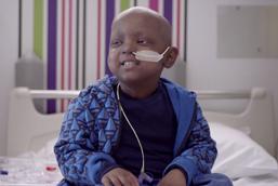 Adyan, sitting on a hospital bed
