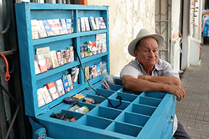 An image of an old man selling cigarettes