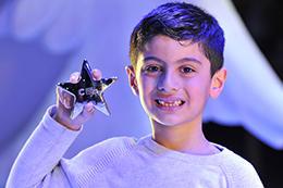 Child holding a Star Award