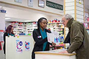 Image of pharmacist with patient