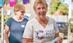Smiling female supporter at CRUK event