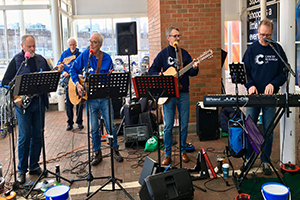 Cancer Research UK fundraising group Loose Change Buskers performing