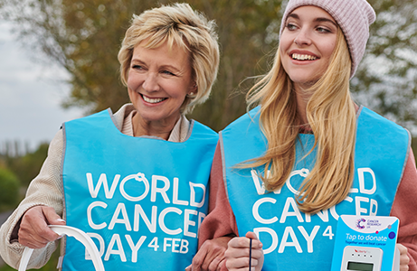 Two volunteers collecting money to donate to cancer research UK for world cancer day 2020