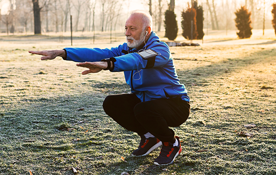 Older man doing squats