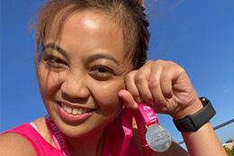 Marathon runner with medal