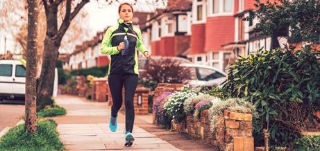 Lady running along street.