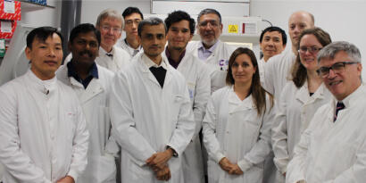 A group of scientists wearing white lab coats
