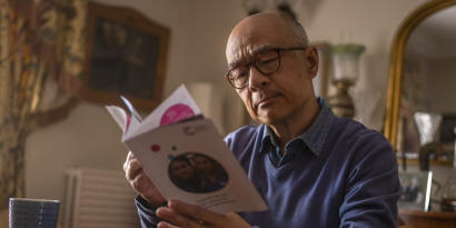 A man reading a leaflet about pledging to leave a gift in Wills