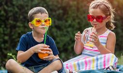 Children having a picnic in the garden