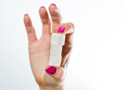 Hand holding sugar cubes.