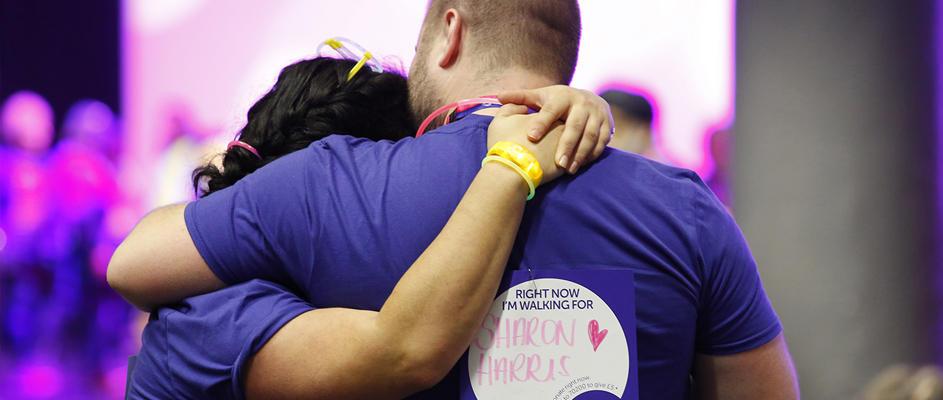 Supporters hugging at Shine Night Walk