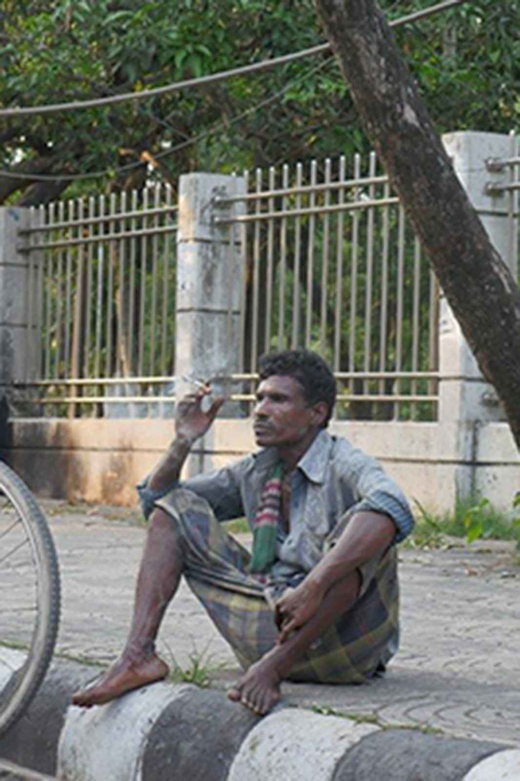 Man smoking a cigarette in the street