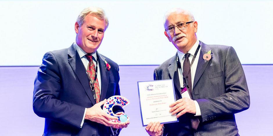 Photo of Stan Kaye receiving an award