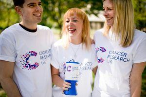 Three people laughing and fundraising