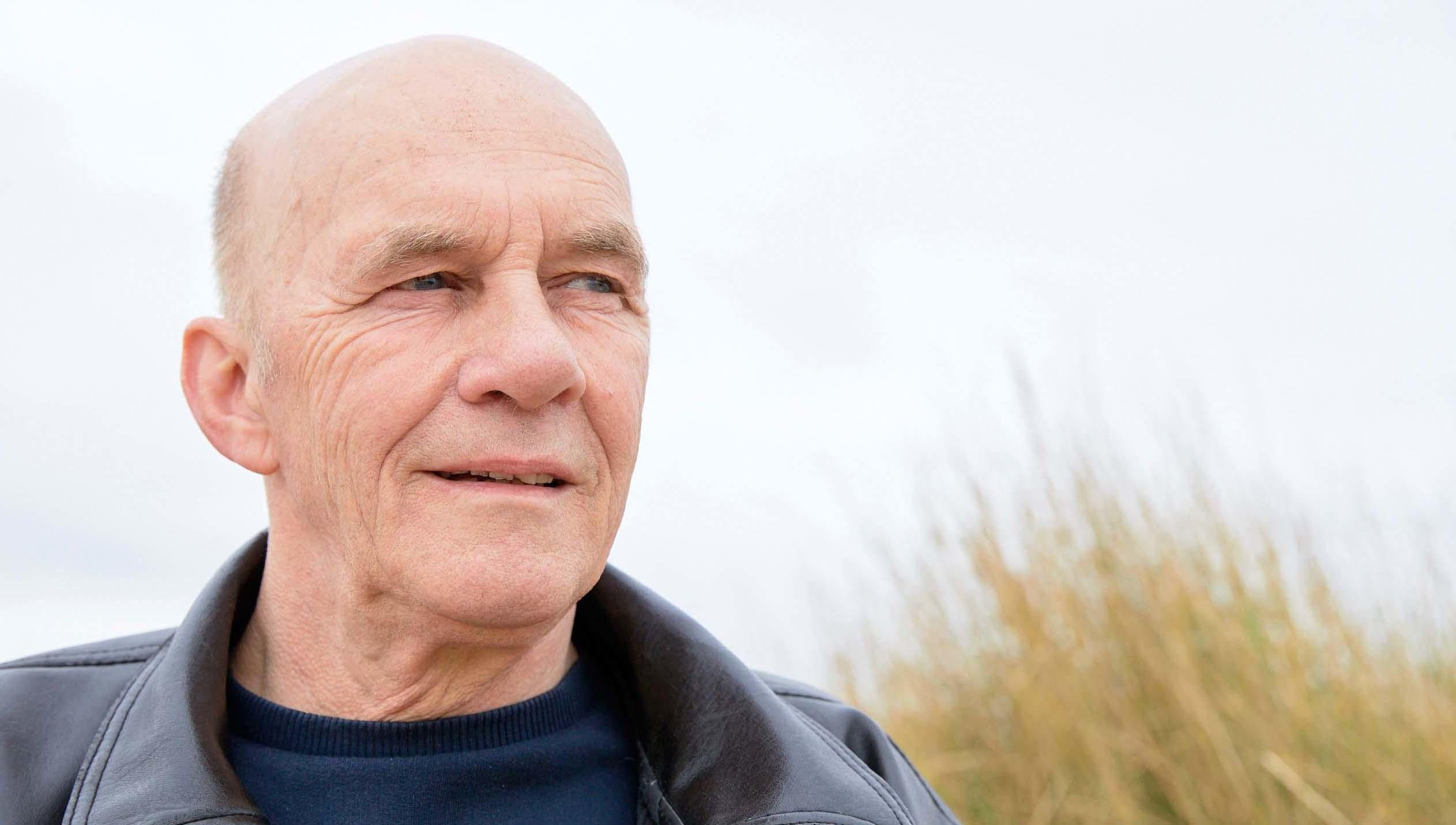 Tommy, a bladder cancer patient, on the beach