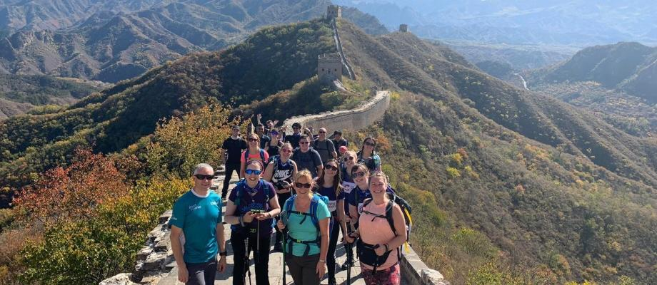 View of Great Wall of China with Cancer Research supporters smiling for a photo