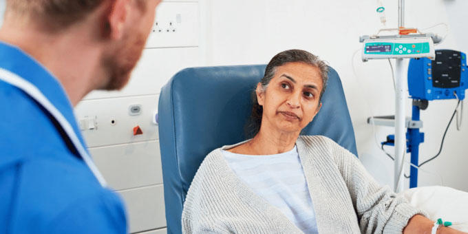 A patient at the hospital speaking to a doctor
