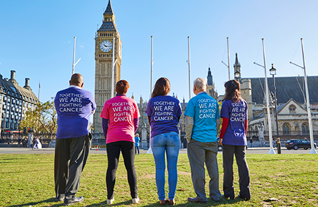 People standing in front of parliament spreading awareness to reduce impact of cancer for world cancer day