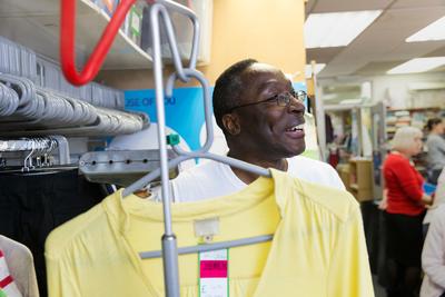 Volunteer inside a Cancer Research UK shop