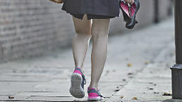 Woman walks to work in trainers