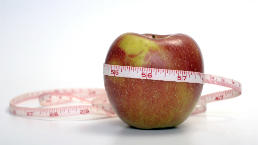 Obesity news. Apple with measuring tape