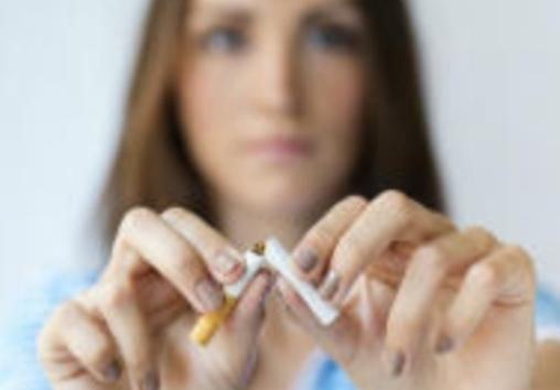 woman breaks a cigarette