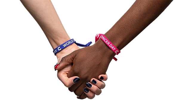 Hands from people of different backgrounds showing support for world cancer day 2020 through wearing unity bands
