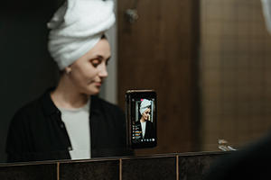 woman livestreaming on her iphone