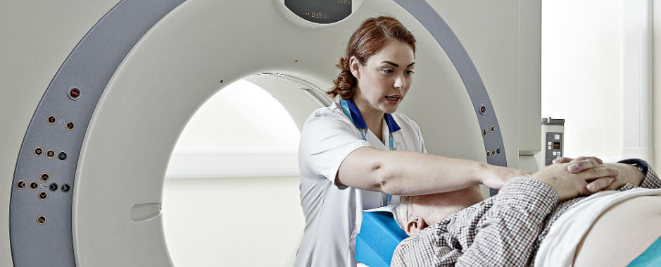 Nurse setting up MRI scan for patient
