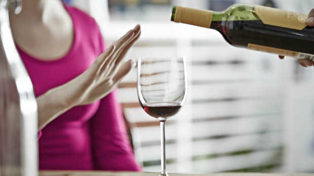 Woman refuses more red wine