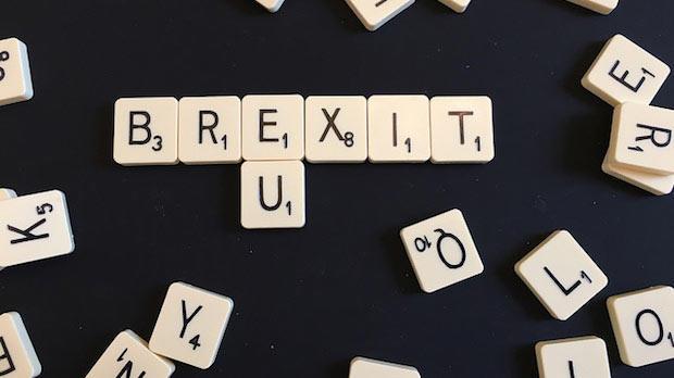 Scrabble pieces spelling Brexit.