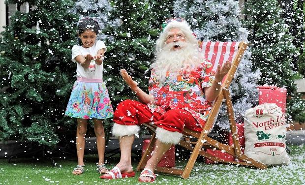Child and Santa at CRUK star awards part 2019