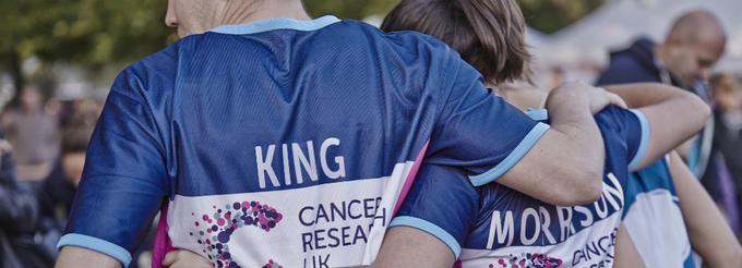 Cancer Research UK Runners with their arms around each other
