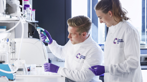 Two Cancer Research UK researchers in a lab