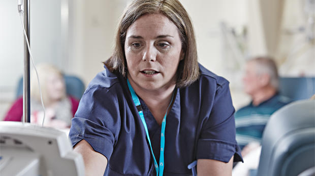 Nurse giving cancer treatment