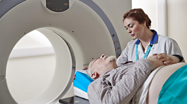 A male patient undergoing a scan