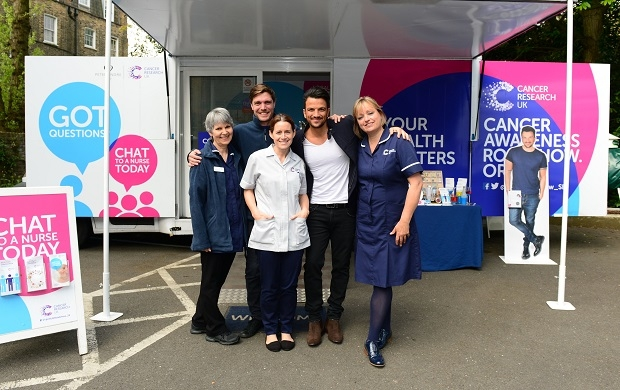 Peter Andre with nurses aboard the London Cancer Awareness Roadshow