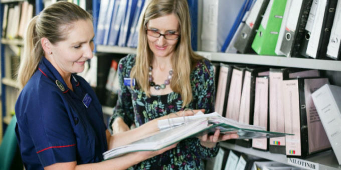 Research Nurses discuss clinical trials at the CRUK Belfast Centre