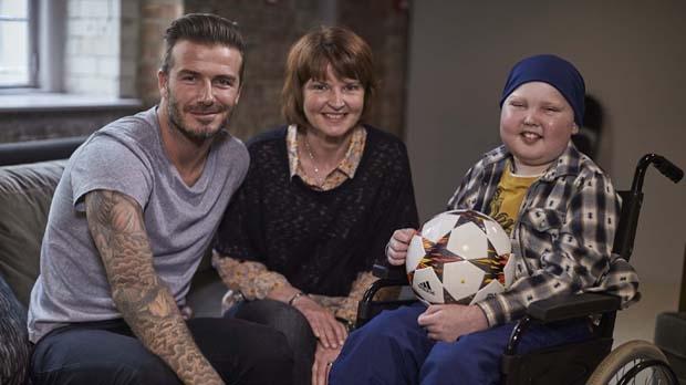 David Beckham meets Lloyd Burton and his mother, Di.