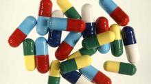 An selection of different coloured drug capsules