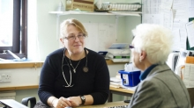 A woman talking to her GP