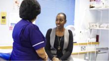 Image of nurse speaking to patient