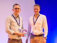 Edd James receiving his CRUK Inspiring Leadership Research Engagement prize from Iain Foulkes