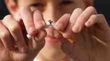 A person breaking a cigarette