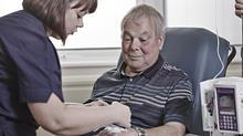 A man receiving treatment from a female nurse