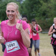 Woman running a Race for Life 10k