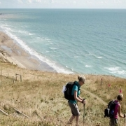 Challengers walking along the coast