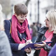 Member of the public signing a Cancer Research UK campaign petition