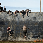 Mudders taking on the wall
